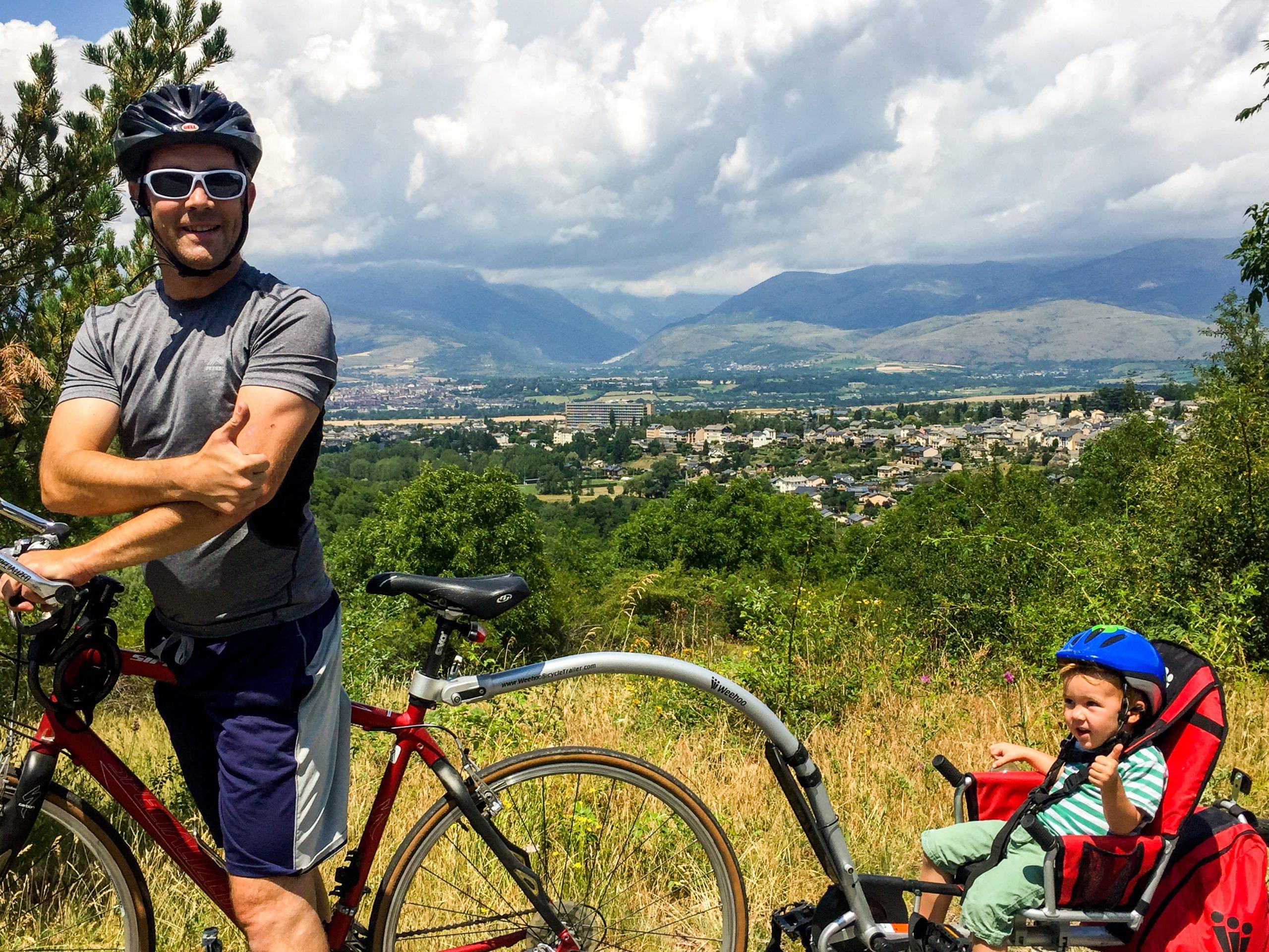 man riding bike in mountains